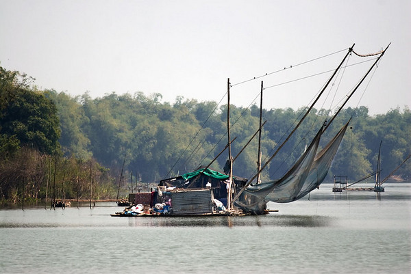 A floating house on the Sakae Krang River<br /> <br /> This raft reflects the lifestyle of the Uthai Thani people, that has always been linked with water.  These floating houses are natural fish farms.