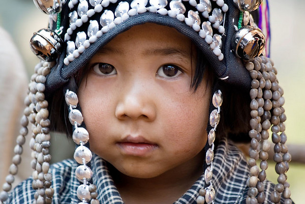 Elaborate traditional headdress on a very young Akha girl