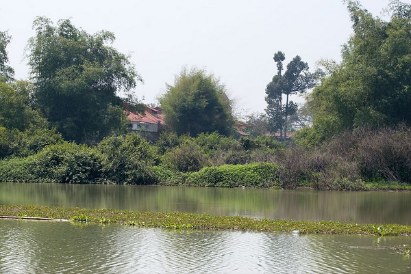 Passing homes in the peaceful countryside along the Sakae Krang River