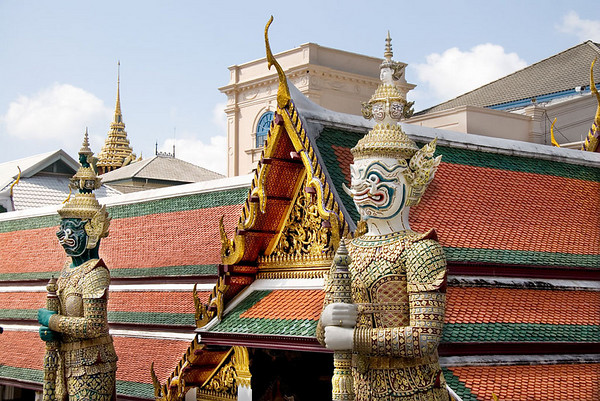 The cho fa, which means tassle of air, is the most recognizable Thai architectural detail.  it is the gold curved shape adorning the corner of the roof.  Its shape is thought to derive from a fierce bird featured in Hindu mythology.