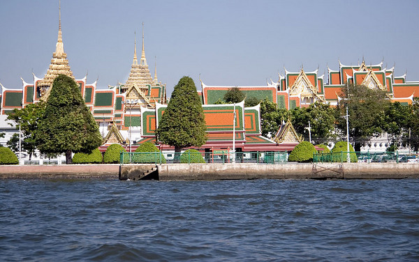"The Grand Palace and Wat Phra Kaeo (Emerald Buddha) complex, the ancient city's defining landmark since 1782<br /> <br /> Wat Phra Kaeo is Thailand's holiest temple.  King Rama IV ruled from this palace, expanded trade with the west and was romanticized in the musical ""The King and I"".  The palace is a massive complex of gilded wats (temples)and ceremonial halls."