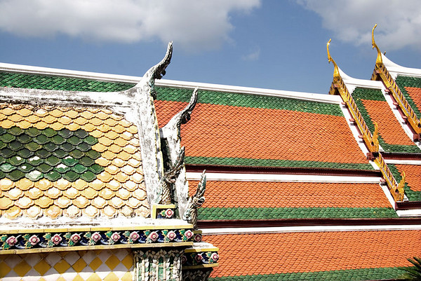 Colouful green and ochre tiled roof depicting cho fa, The Grand Palace, Bangkok.