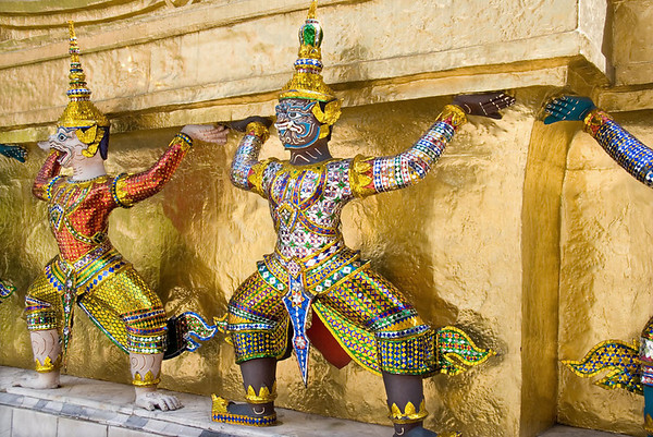 Khon figures guarding a Chedi, The Grand Palace, Bangkok. A Chedi is a solid structure that encases a relic of the Buddha.