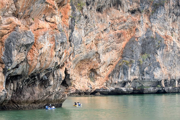 The seakayaks provide a perspective of size of the enormous cliffs, Phangnga Bay.
