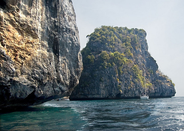 Entering Nui Bay on long-tail boat, Phi Phi Islands<br /> <br /> Note how the salt water has dissolved the limestone rock at sea level.