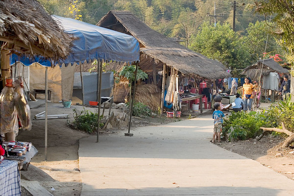 Street in Mien Hill tribe village depicting wares for sale - a safe alternative to their former drug smuggling