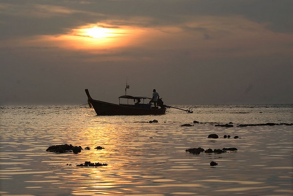 Long-tail boat in early morning sunrise, Phi Phi Don