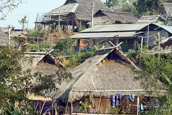 The Hill Tribe village of Mae Salong (about 3,000 ft. above sea level)<br /> <br /> The inhabitants are members of the Akha Tribe.  Huts are compact and life has changed little in centuries.