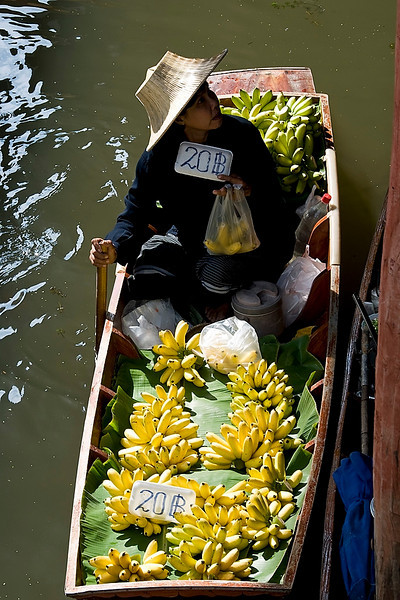 We bought some bananas from this lady.  Small but very sweet!