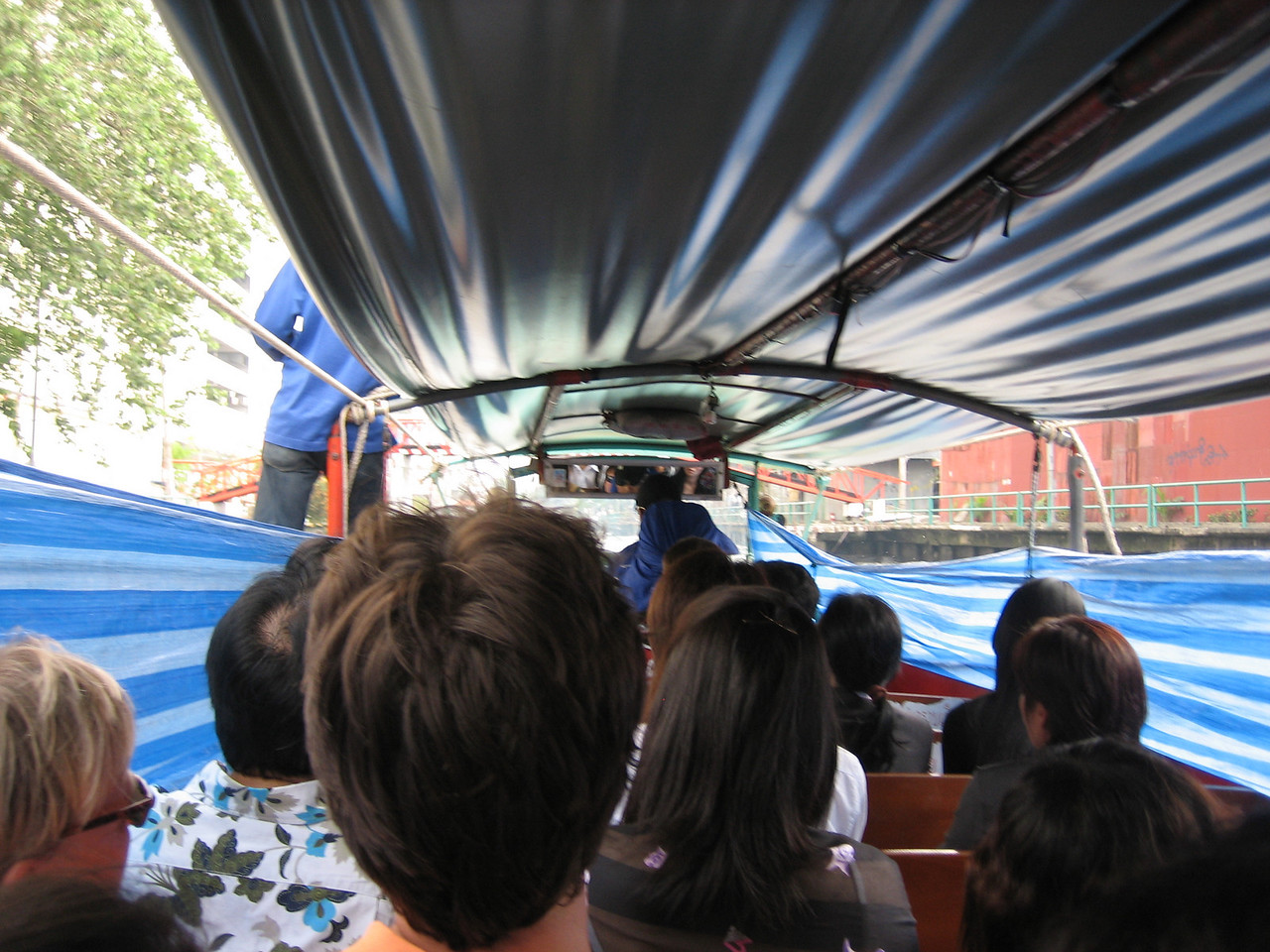 Blue & white tarps keep the splashes off and the metal roof lowers for bridges.  Better than a ride at Disneyland!