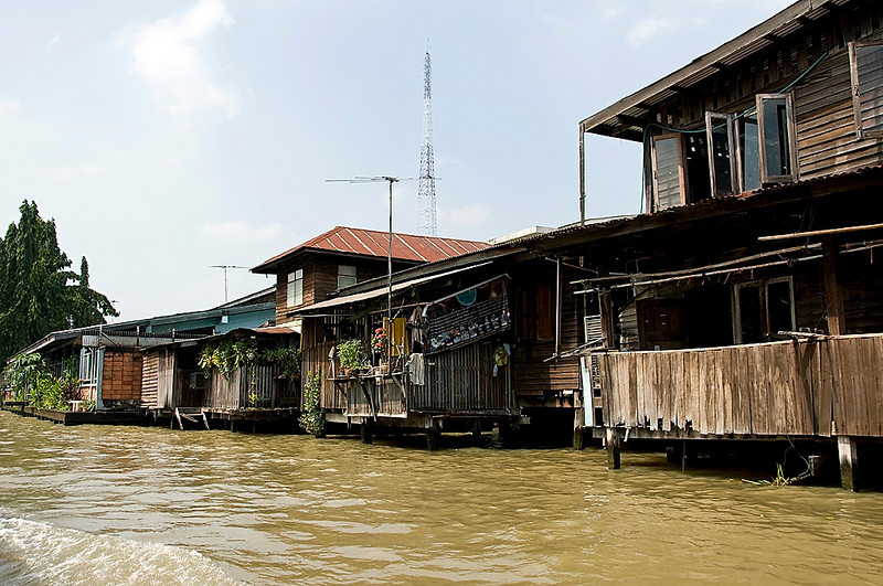 We rode a lang-tailed boat along the klongs (canals) around the outskirts of Bangkok. This is a typical scene.
