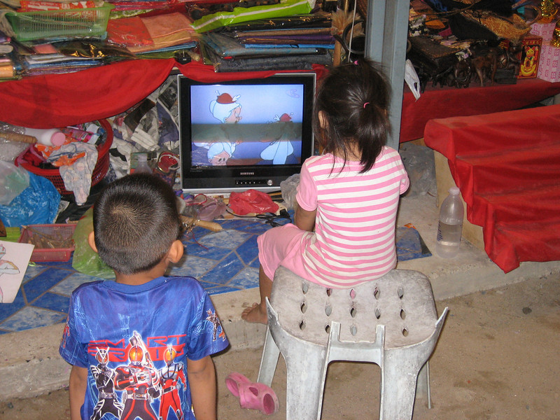 Children of the market vendors.  Guess TV babysitting is a worldwide practice, eh?