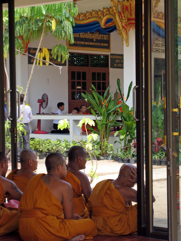 One bored monk listening to the sermon.  Reminds me of my times in church!