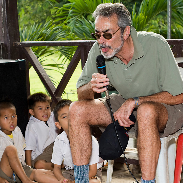 Andy singing a spirited version of Old McDonald to the children.