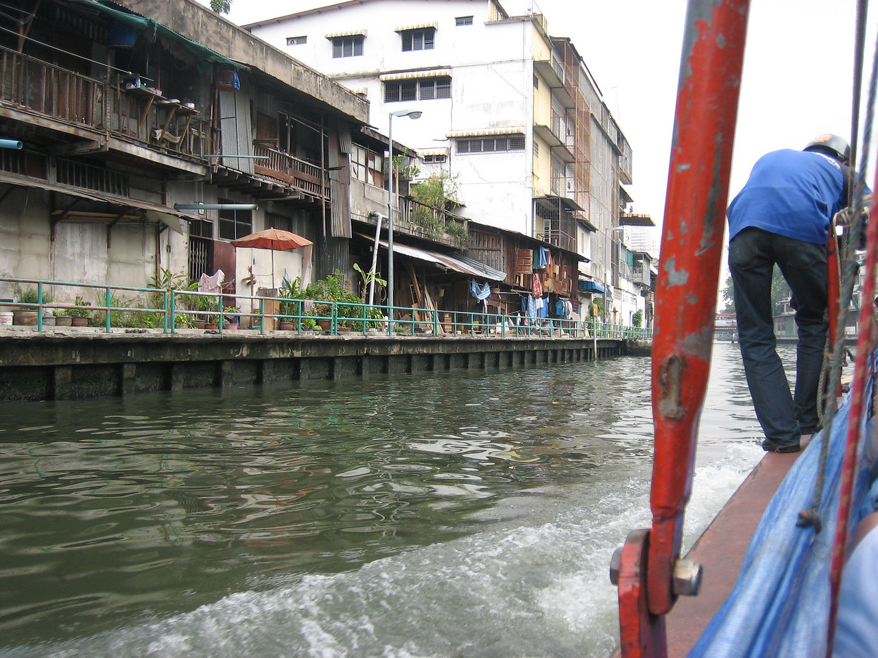 Canal boats get you through town FAST! Ticket-taker with helmet on stradling the side.