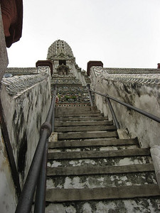 Wat Arun, Temple of the Dawn, Bangkok  ...do not climb these stairs in  shoes, especially when raining... :)