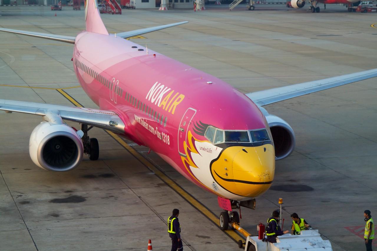 Cute airplane at the gate.