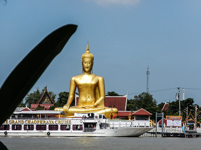 A large Buddha watching over us from the other side of the  river.