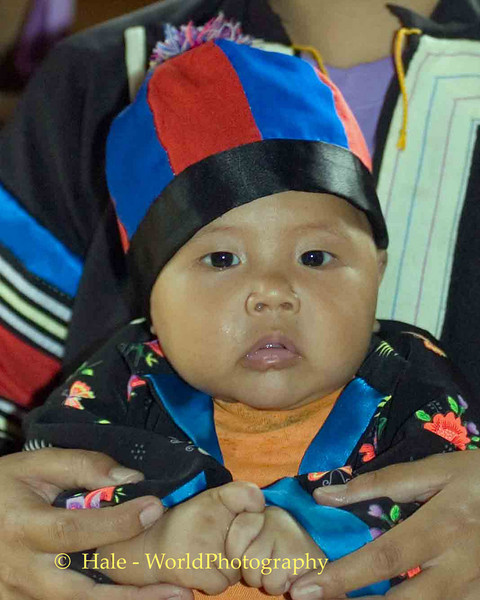 Lahu Hill Tribe Baby In Traditional Clothing Giving Wai Greeting, Maehongson Thailand