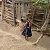 Lahu Hill Tribe Elderly Woman Walking Towards Home, Maehongson Thailand