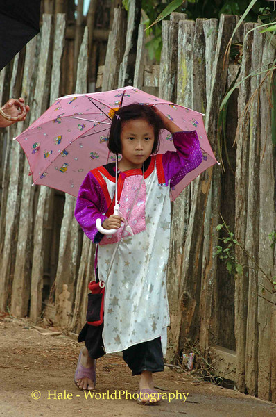 Lisu Young Girl Walking in the Rain, Maehongson, Thailand