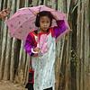 Lisu Young Girl Walking in the Rain, Maehongson, Thailand