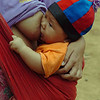 Lahu Hill Tribe Baby Feeding on the Run, Maehongson Thailand