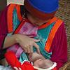 Loving Lisu Mother Feeding Her Baby, Maehongson Thailand