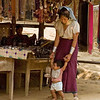 Padaung Mother Teaching Her Baby to Walk in Refugee Camp, Maehongson Thailand