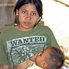 Lahu Hill Tribe Roadside Vendor Feeding Her Baby, Maehongson Thailand