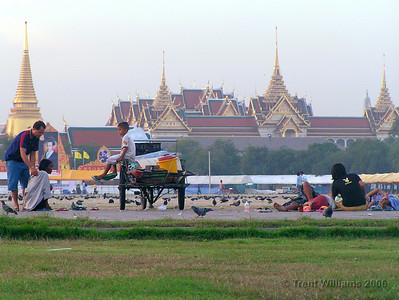 The Grand Palce in Bangkok, with homeless thais in the foreground. This park has 100+ people living in it.