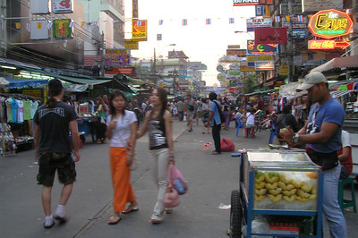 Khosan Road. This place is like a 24 hour 365 days a year fare. Toktok drives trying to scam you, suit guys hasseling you for a sale, Chang Mei (frog women) selling there wares, $3 DVD's, sunglasses, cheap food, prostitutes, ladyboys wanting to suck stuff for 50 baht.