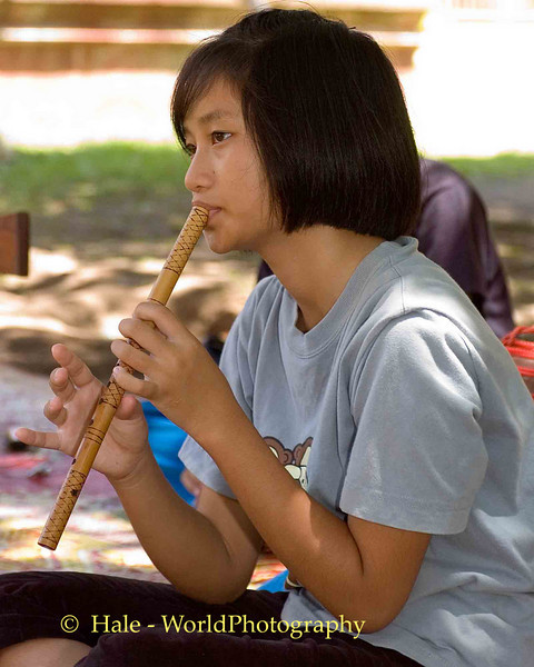 Young Female Student Playing Music On Khlui, Chiang Mai, Thailand