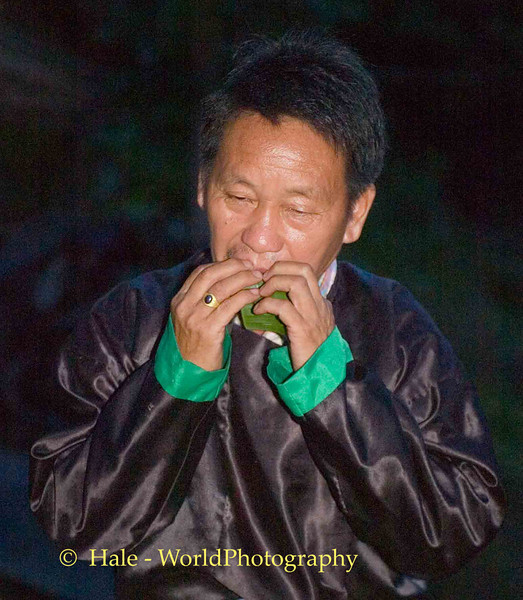 Hmong Man Calling Out On A Banana Leaf, Chiang Mai, Thailand