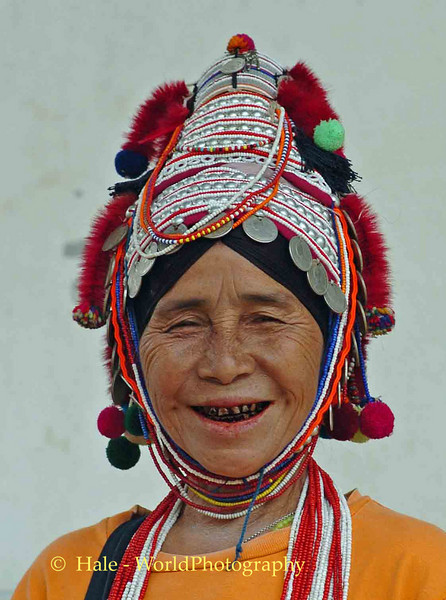 Ahka Hill Tribe Elderly Woman In Traditional Silver Coin Adorned Hat with Beads, Chiang Rai, Thailand