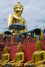 Golden Buddha with Seated Buddhas in Sop Ruak, Golden Triangle Area, Thailand