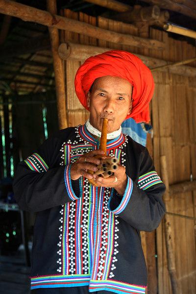 Padong man, playing flute (Chiang Rai Province)