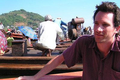 Stu not very happy after the experience. In the background are Burmese immigrating / traveling to Thailand.