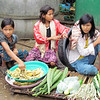 Children sell vegetables near their homes in the Mae La refugee camp. Terri Lackey