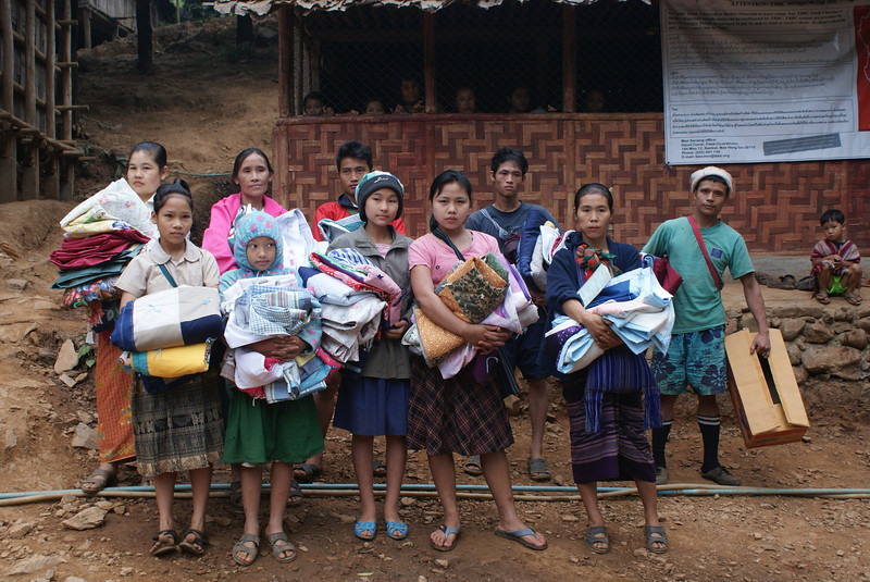 Refugees in one of 9 camps along the Thai/Burma border receive LWR quilts when the Thailand Burma Border Consortium distributes them in December. Photo from TBBC