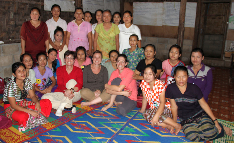 Members of the Karen Women's Organization with visitors, Terri Lackey, red shirt, Joanne Fairley, center, and Melanie Gibbons, pink shirt. Photo by TBBC employee