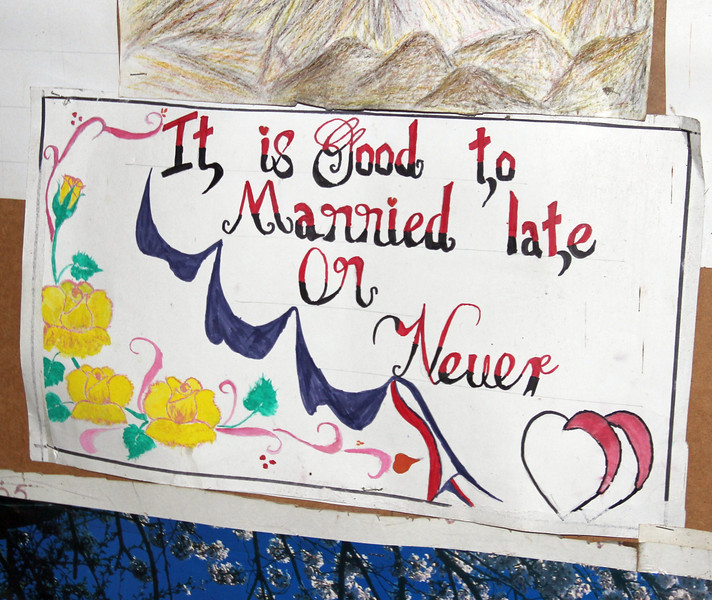 Sign in the Karen Women's Organization center. Photo by Melanie Gibbons