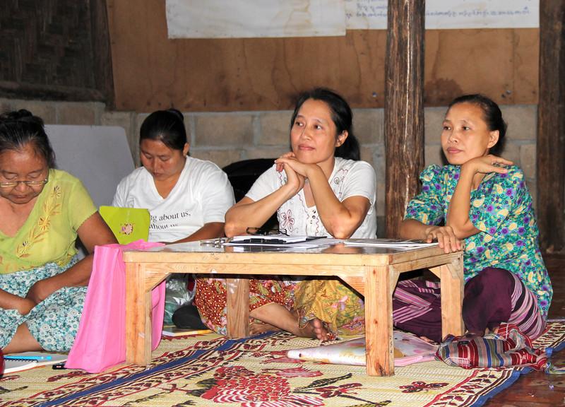 Ko Lo Wah, center, char of the Karen Women's Organization in the Mae La Camp. Melanie Gibbons