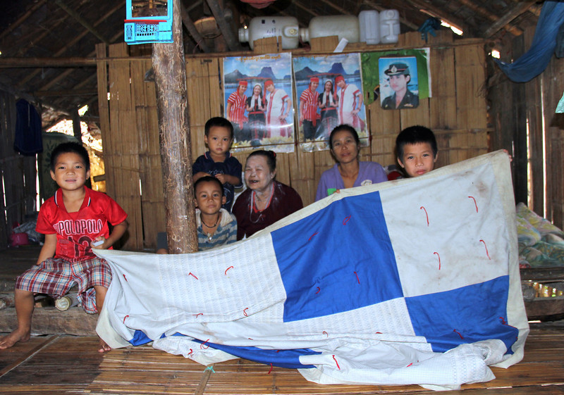 MeLe Myee (third from right) has lived in the refugee camp for 20 years with three nieces and four children. One niece Gyigyi Aye, second from right, has lived in the camp four years. The family has several LWR quilts; the boys are holding up one they own. Melanie Gibbons