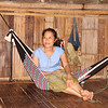 Ko Lo Wah sits in a hammock made from an LWR quilt. Melanie Gibbons