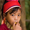 Paduang Young Girl or Padaung Young Girl Having A Snack, Maehongson Thailand