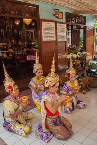 Theparak Shrine, Bangkok, Thailand. Thai dancers dressed as apsaras perform traditional dance and rituals.