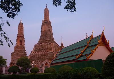 Sunrise at Wat Arun Ratchawararam Ratchawaramahawihan, Bangkok, Thailand.  Wat Arun Ratchawararam Ratchawaramahawihan or Wat Arun is a Buddhist temple in Bangkok Yai district of Bangkok, Thailand, on the Thonburi west bank of the Chao Phraya River.