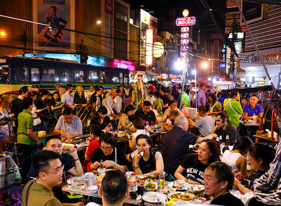 Where better to eat street food than right there on the street? This is in Chinatown.
