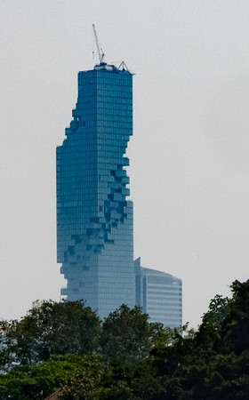 This is in downtown Bangkok, one of the craziest building designs I've ever seen. This is a severe crop. For a better image of this amazing building, see this: https://www.e-architect.co.uk/images/jpgs/thailand/mahanakhon_tower_as280709_5.jpg